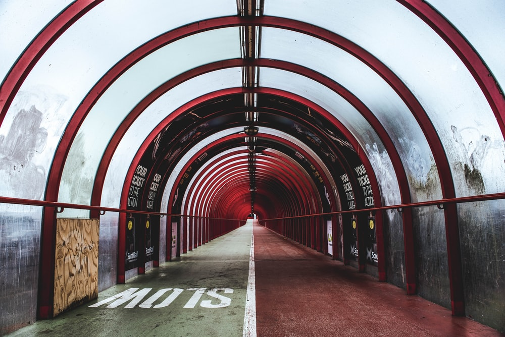empty red and white glass tunnel