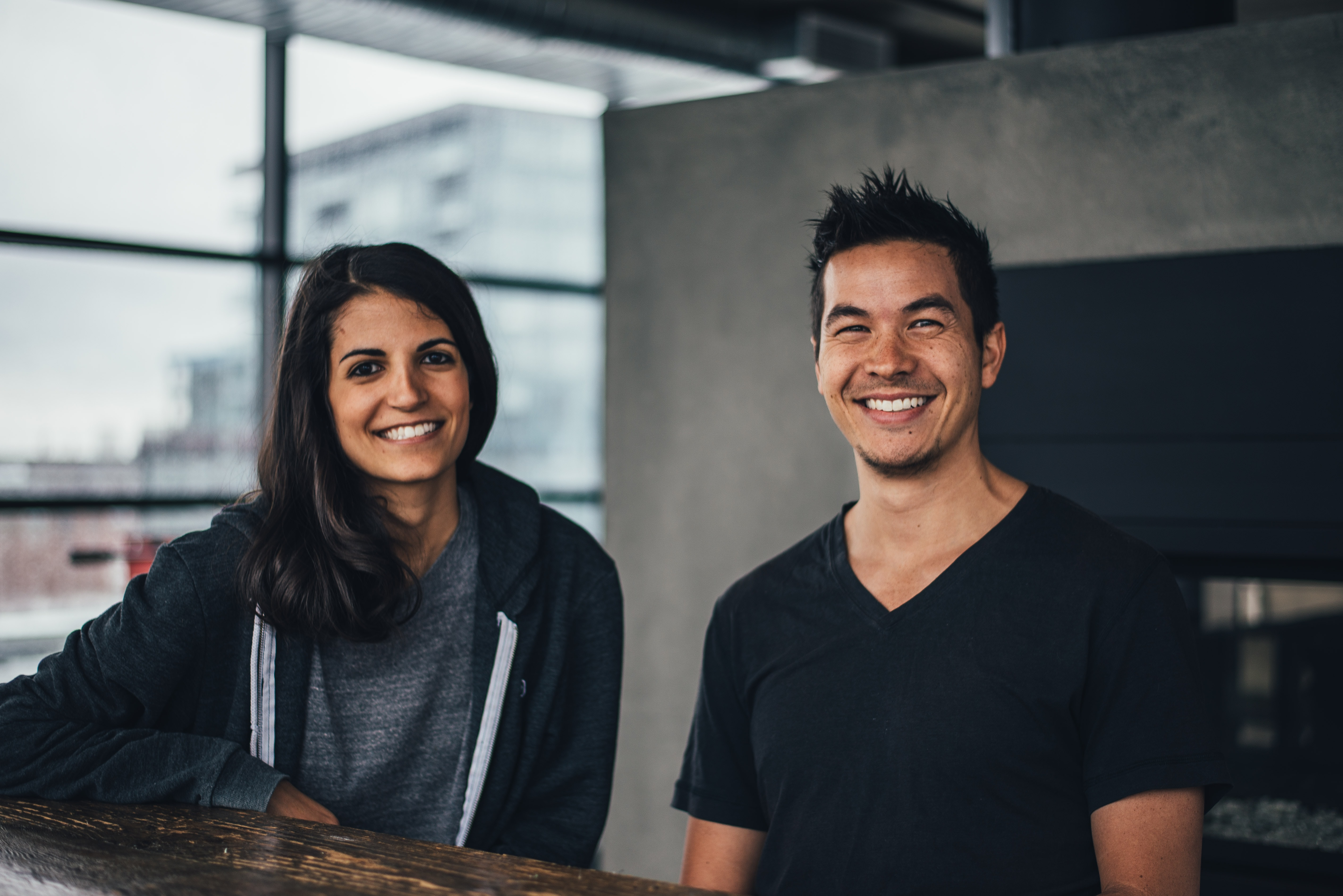 Man and woman smiling contentedly inside a loft