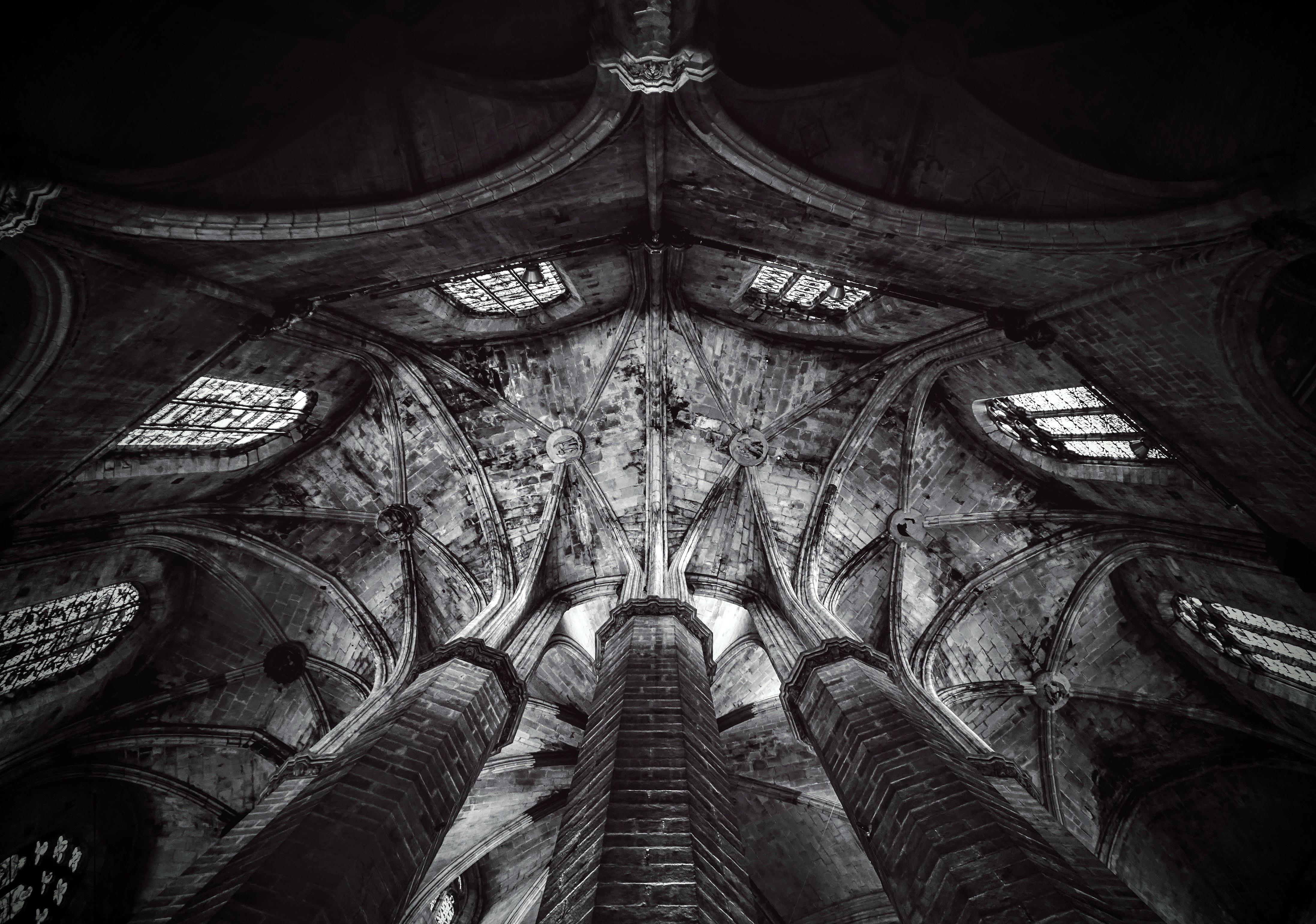 grayscale photo of concrete building interior
