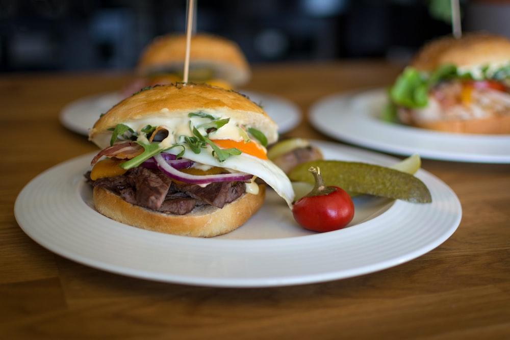 three plate of burgers