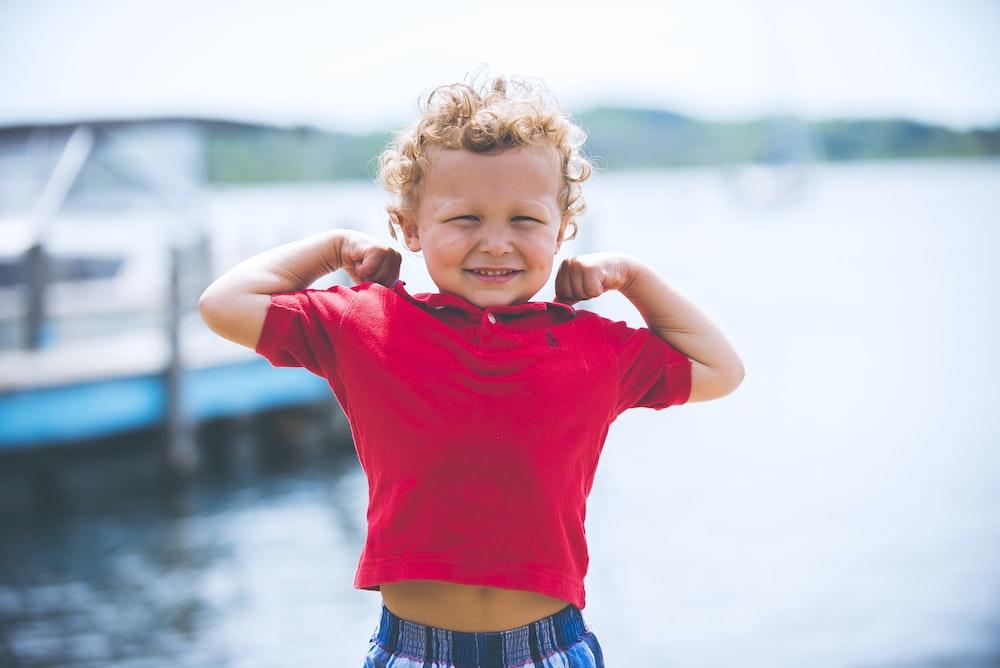 boy standing near dock