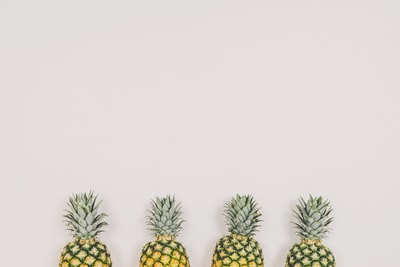 four pineapples on white background summer teams background