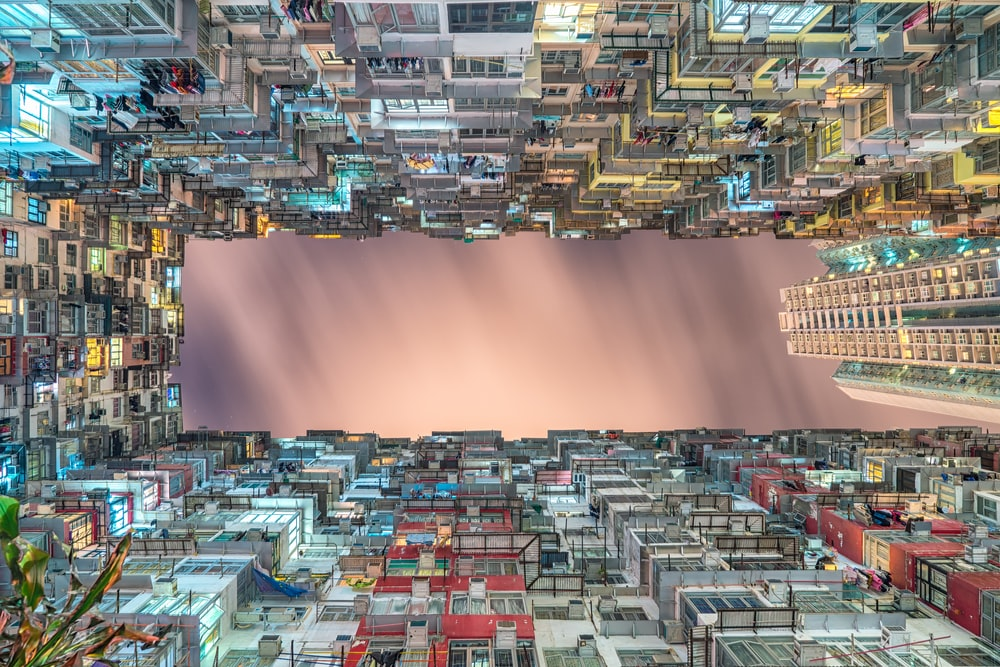 worm's-eye view of buildings painting