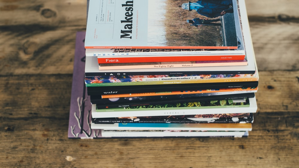 assorted-title softbound book on table
