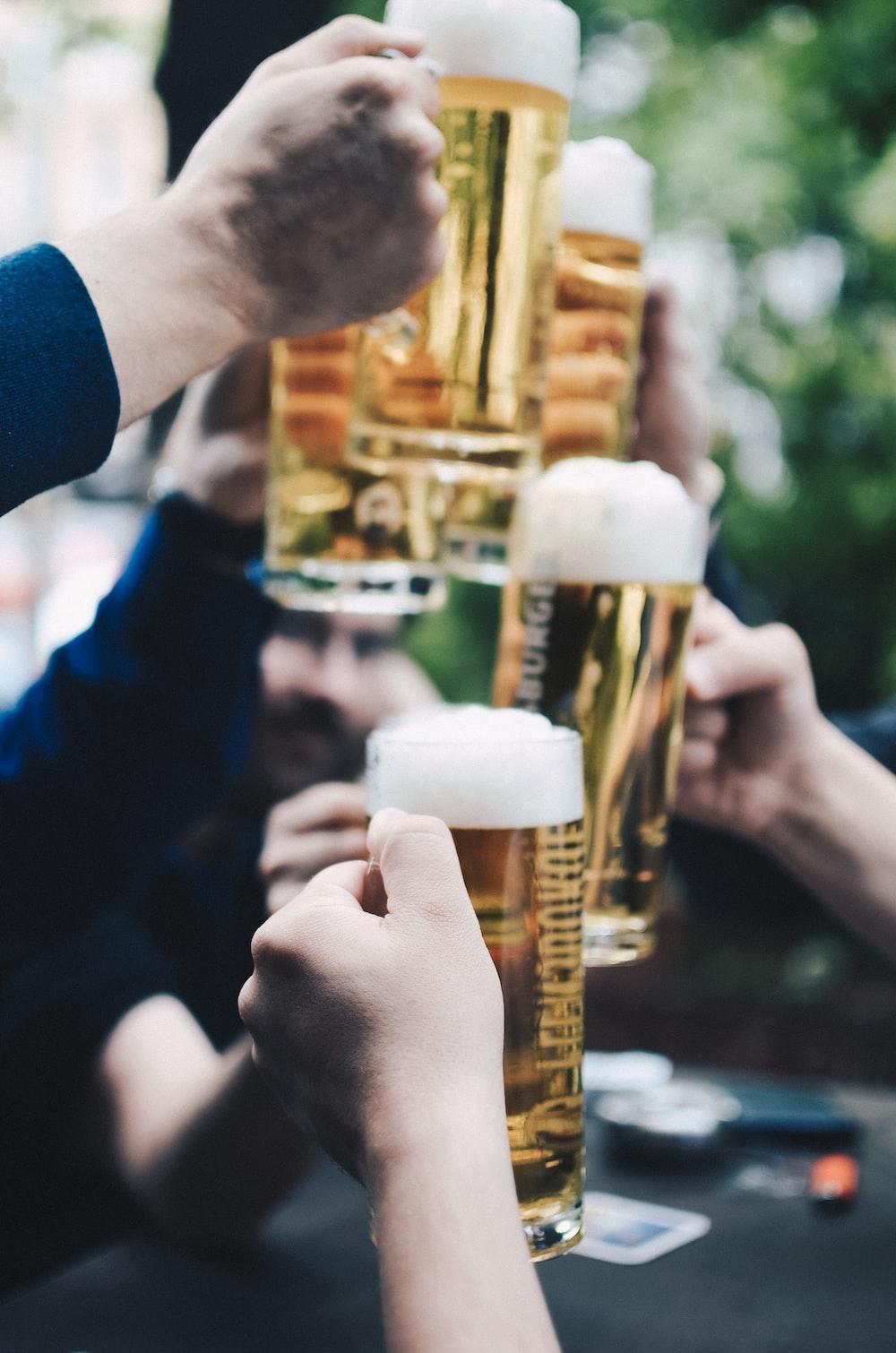 five beer mug filled with beer