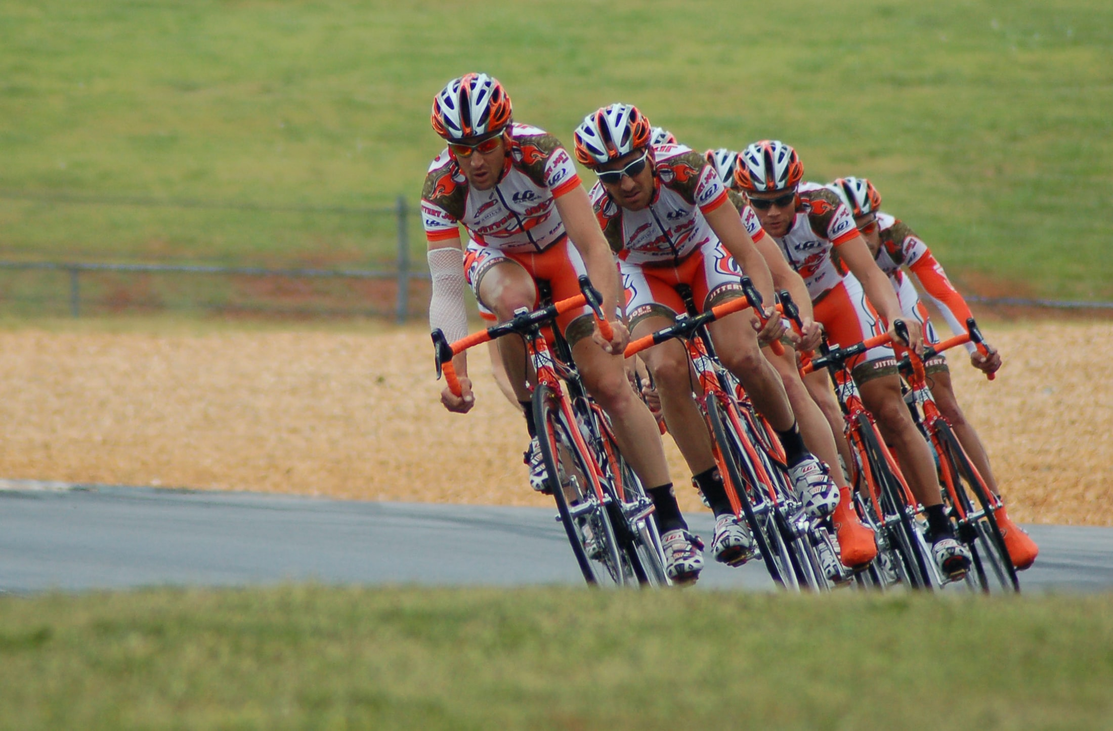 A team of four cyclists driving at the Road Atlanta bike course