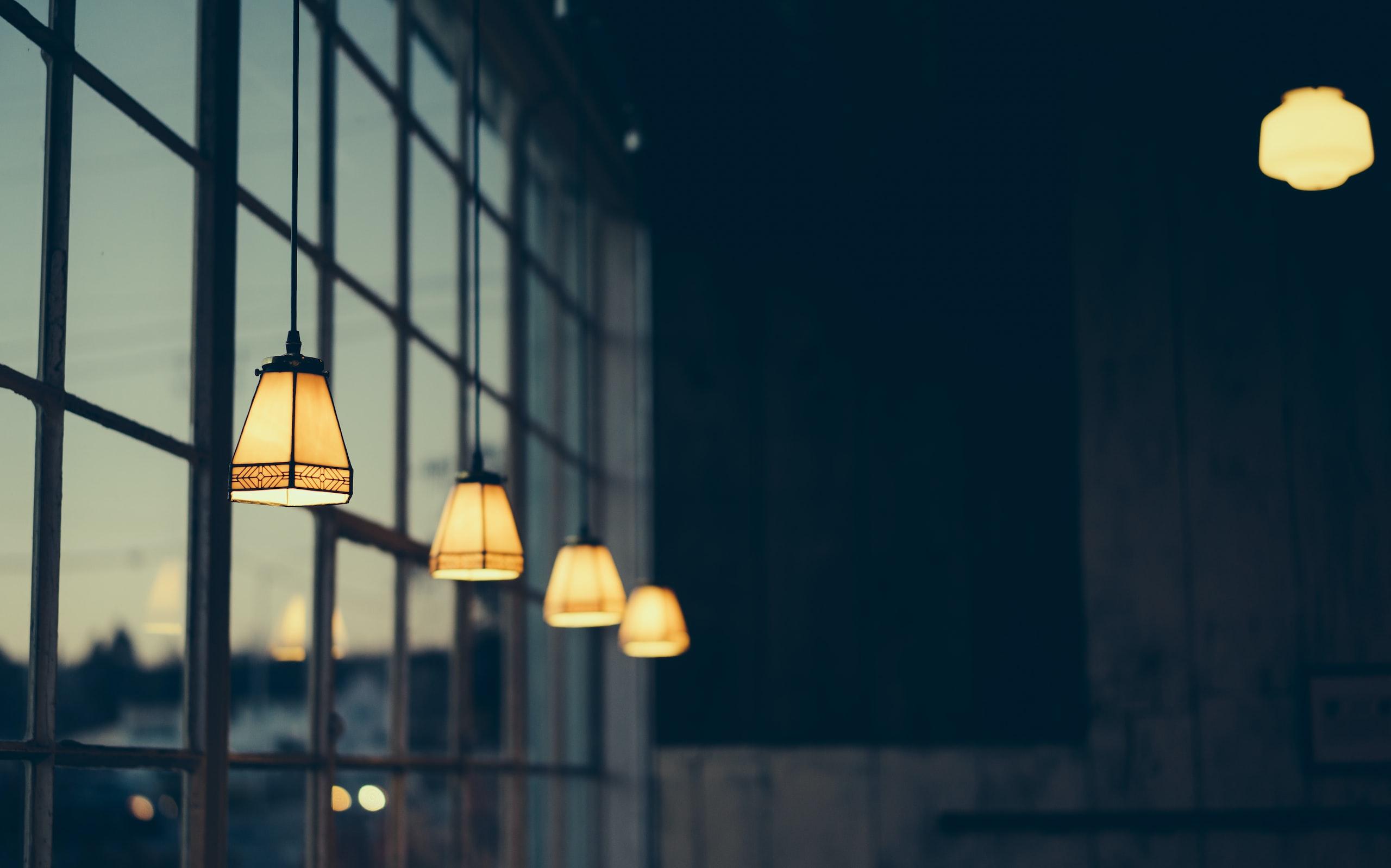Yellow lamps near a window