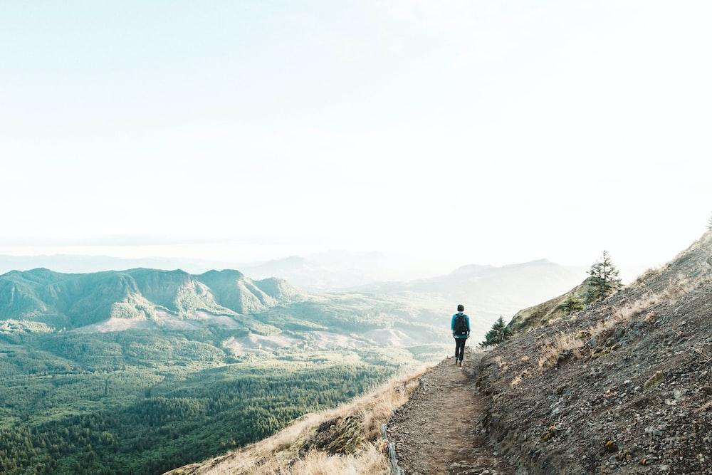 man walking on cliff