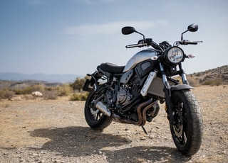black cruiser motorcycle on soil