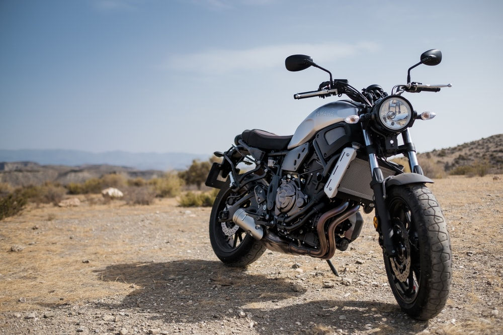 Motorbike pictures download free images on unsplash a motorcycle in the desert in tabernas voltagebd Images