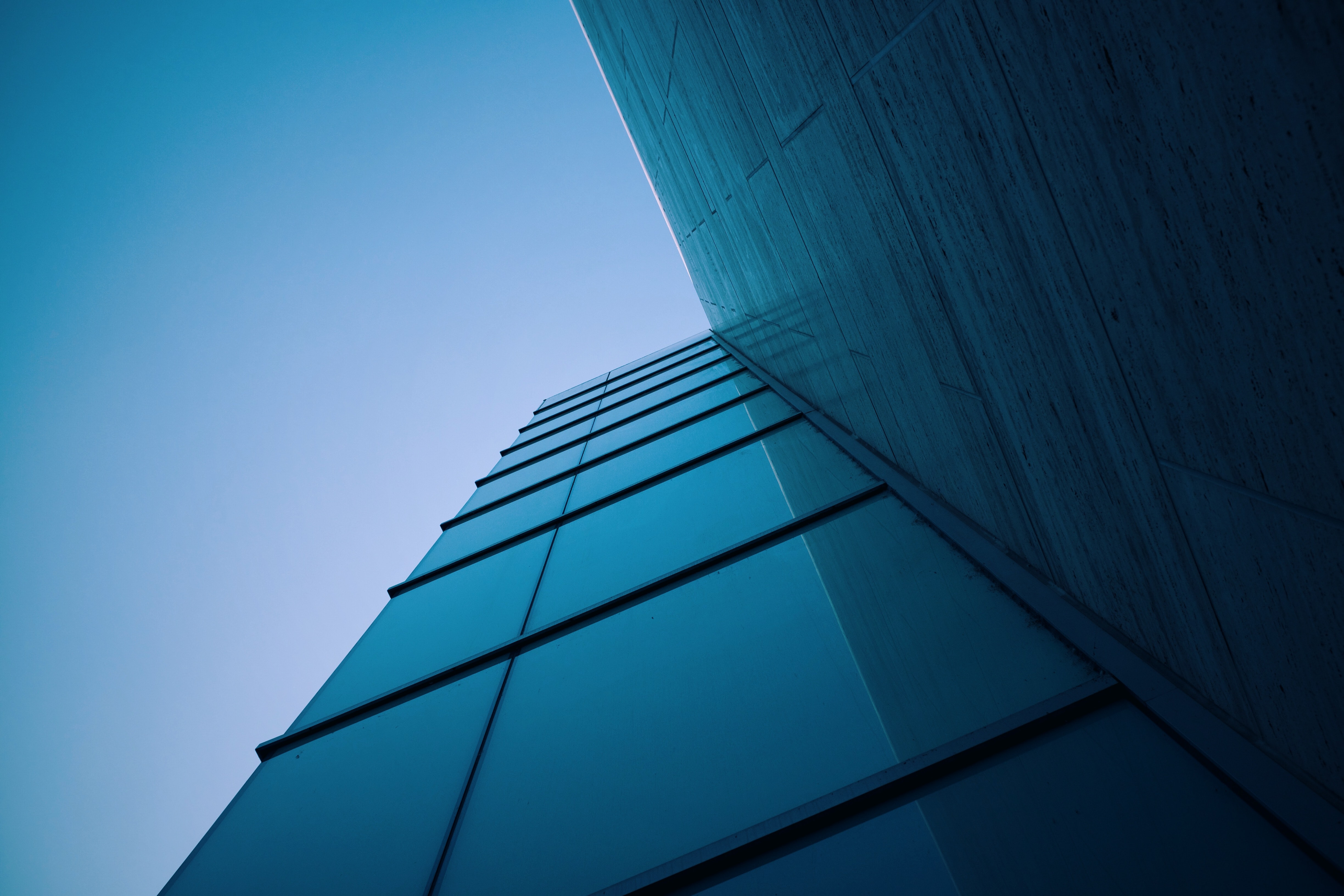A low-angle shot of a corner in a facade of a modern office building