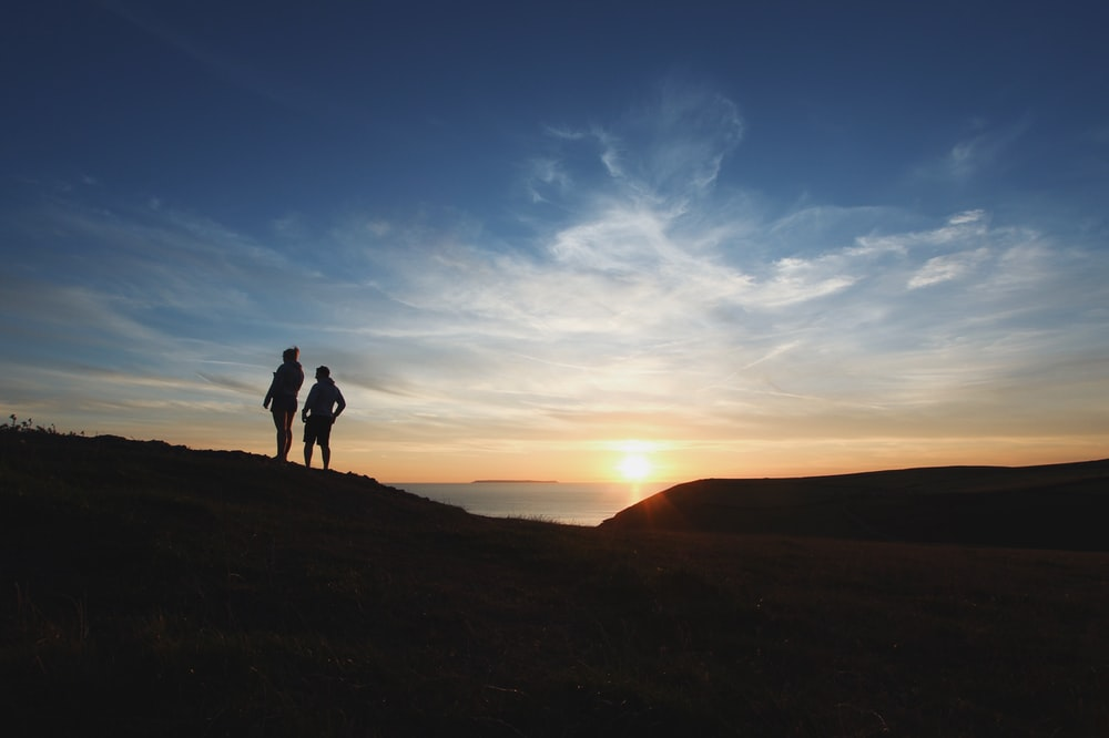 two person silhouette photography