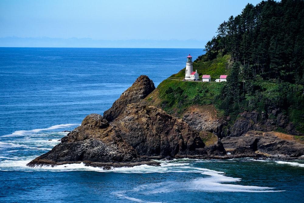 white lighthouse beside sea