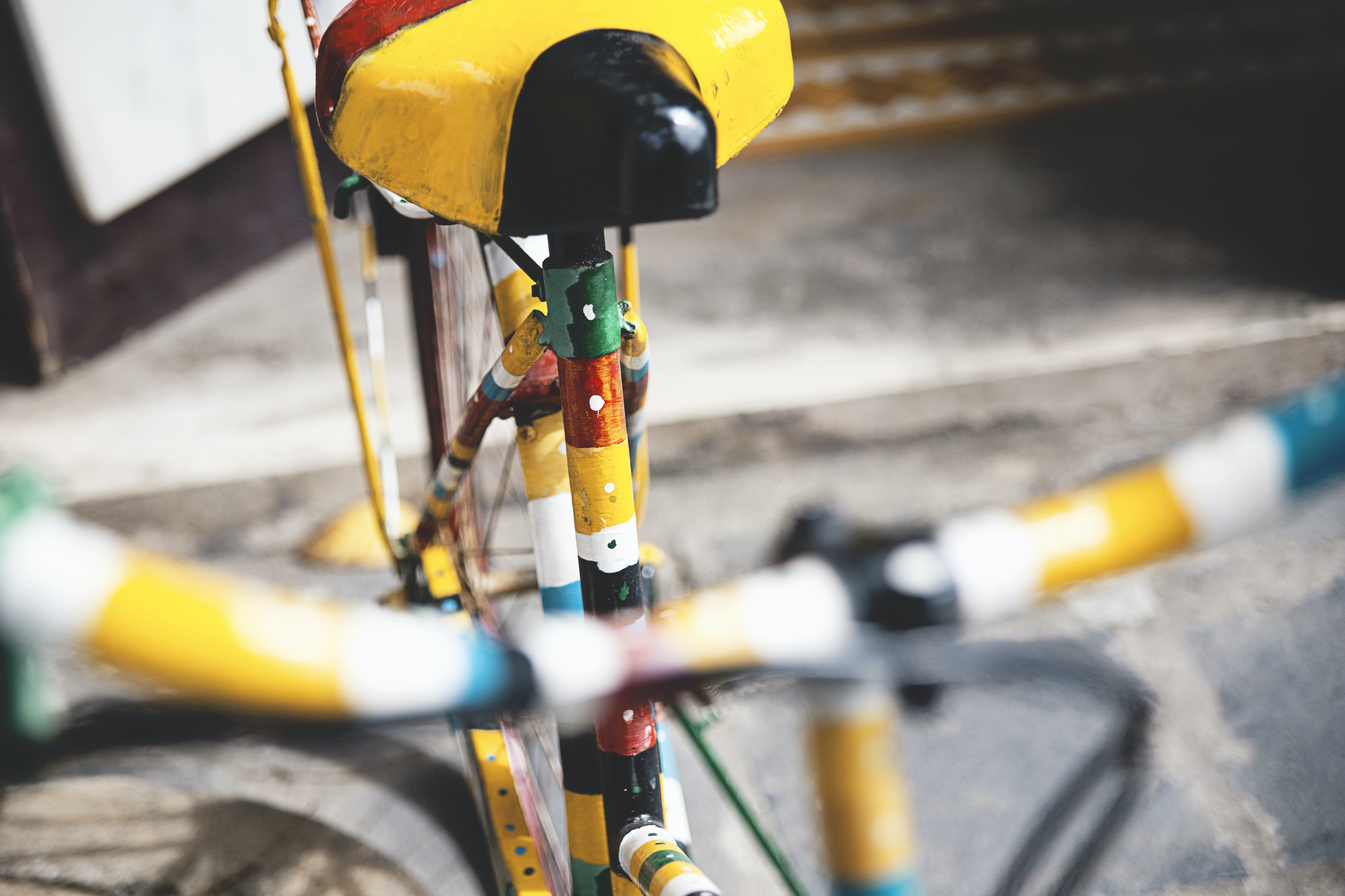 Close-up of a bicycle painted in colorful stripes