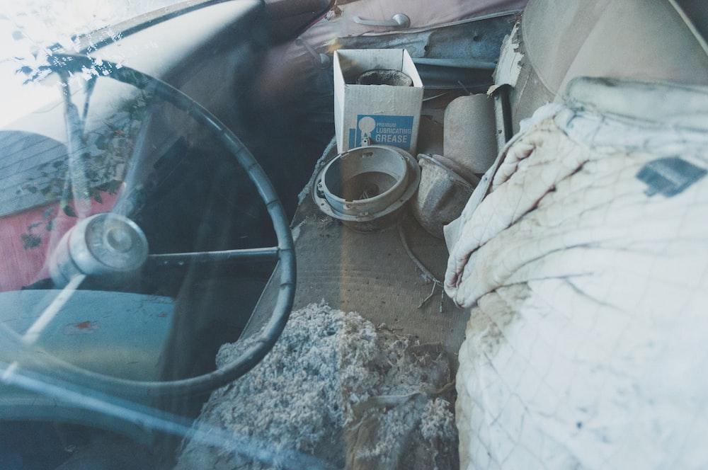 black car steering wheel close-up photography