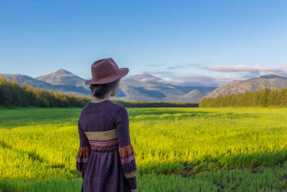 woman standing near rice field