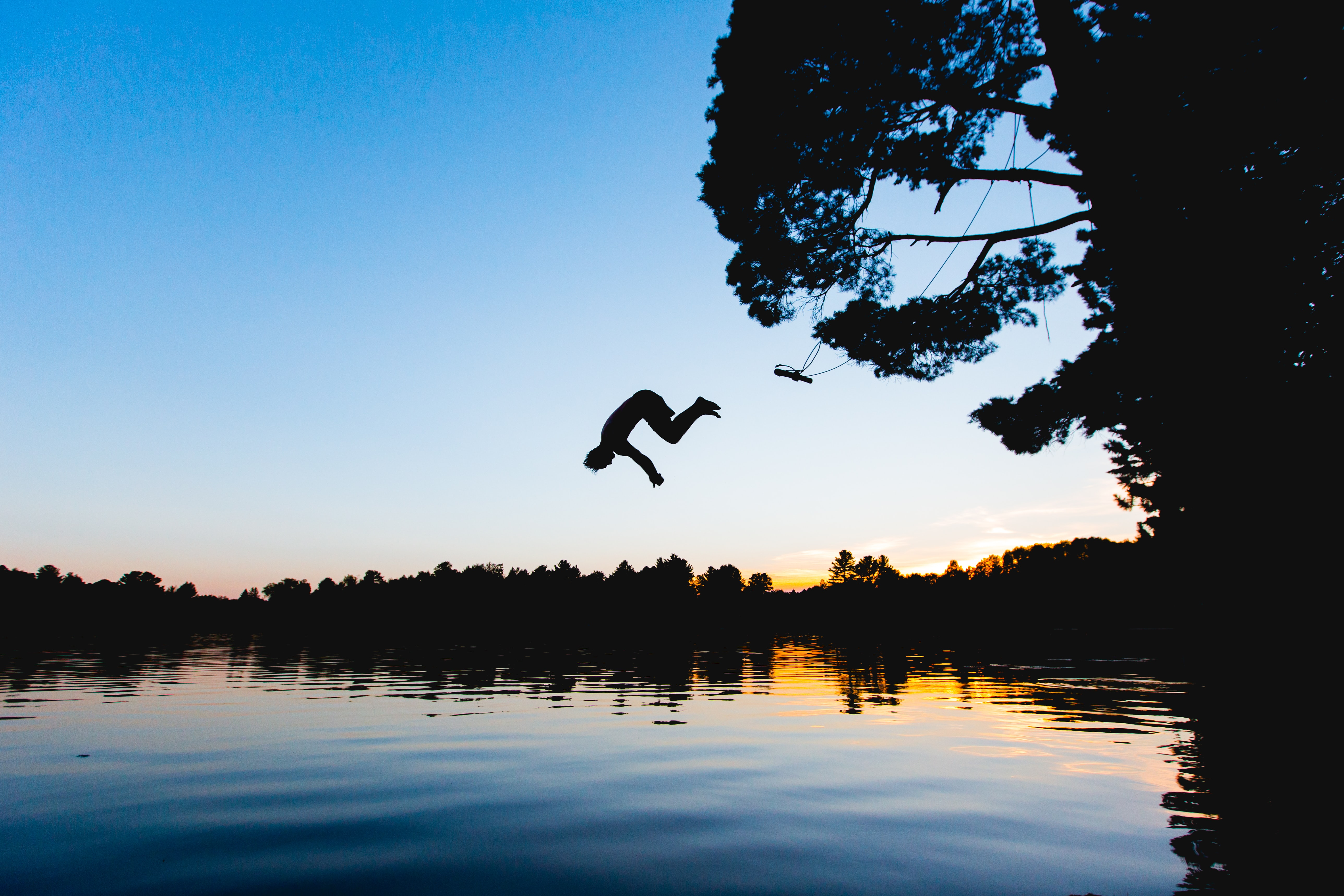 man jump on water at golden hour