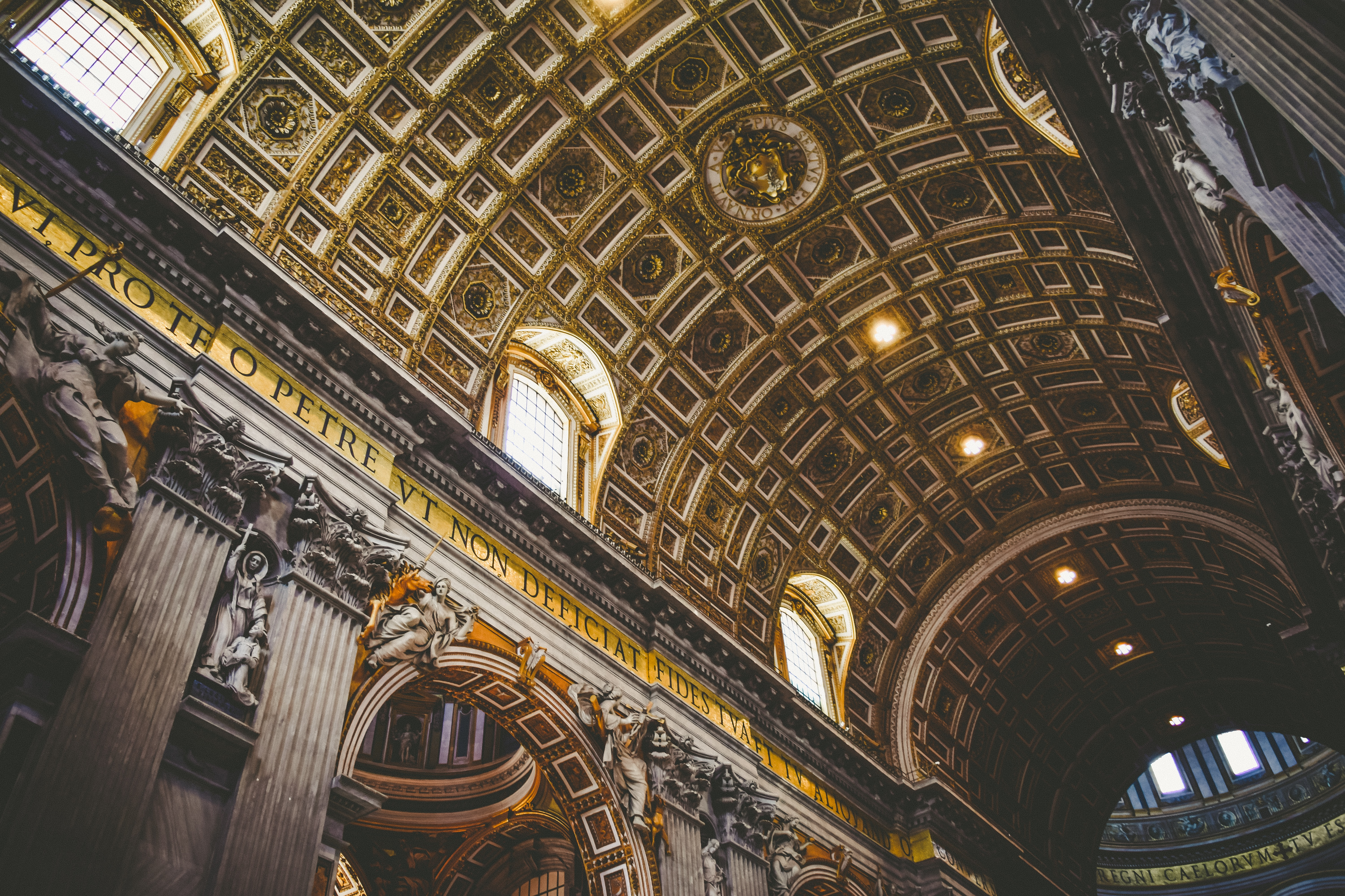 The ornate, gold, carved ceiling in St. Peter's Basilica in Vatican City