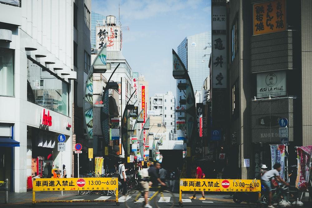 people on street walking in pedestrian at daytime
