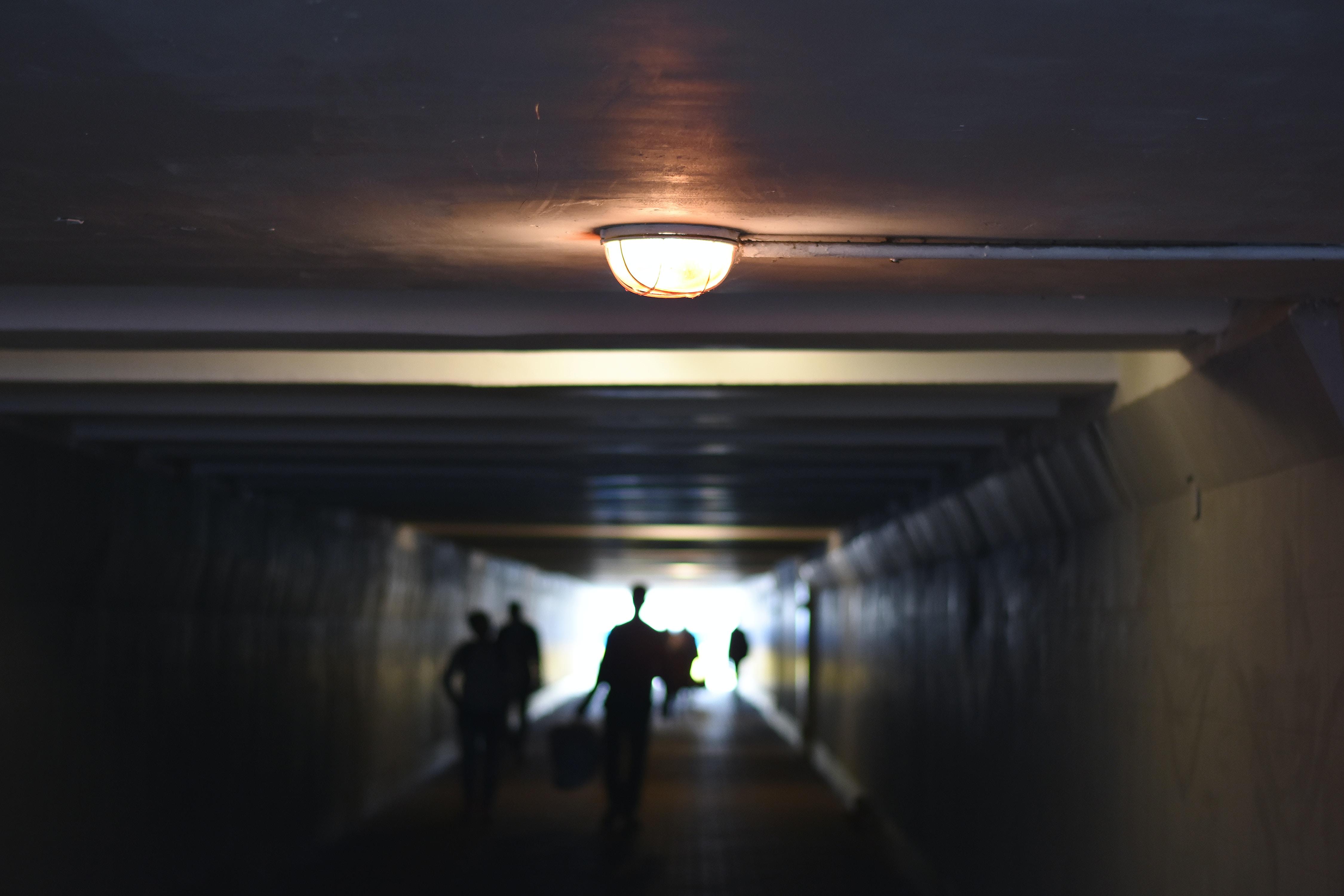 people walking inside tunnel