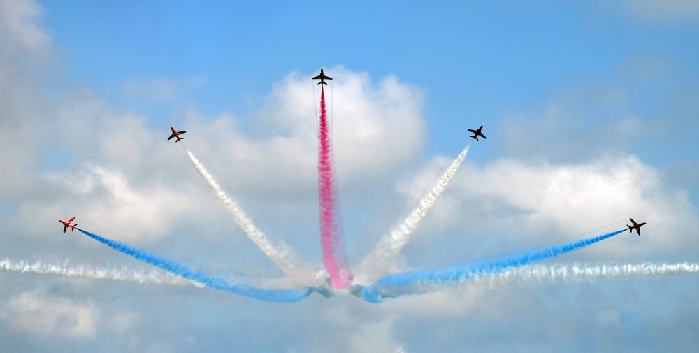 five assorted-color airplane sky show during daytime