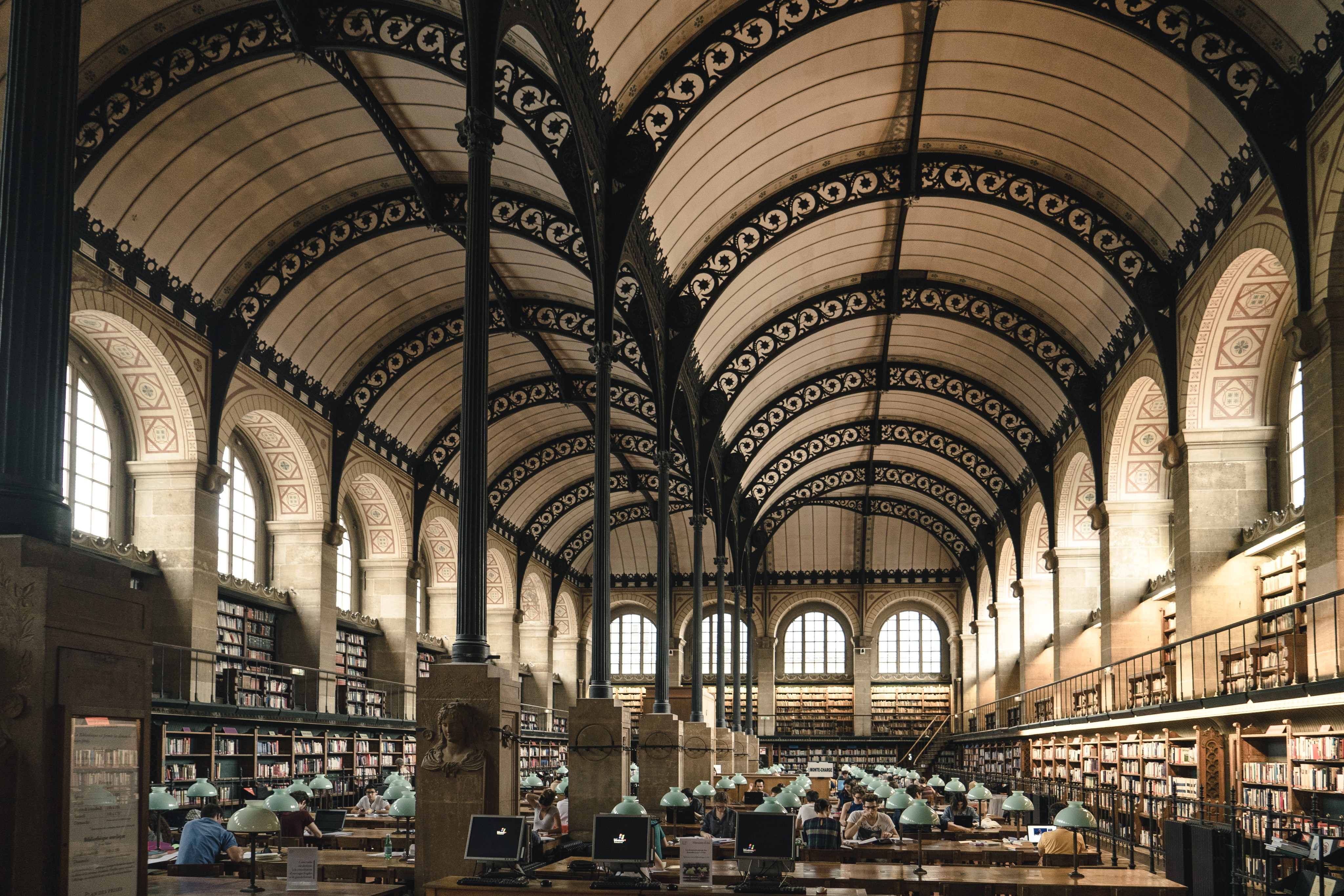 A beautiful library with arches and bookshelves in Paris