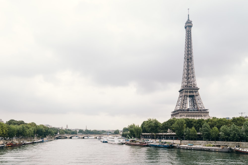 The Eiffel Tower in Paris overlooking the Seine River on a cloudy day