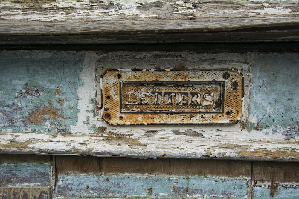 letters signage inside wooden panel