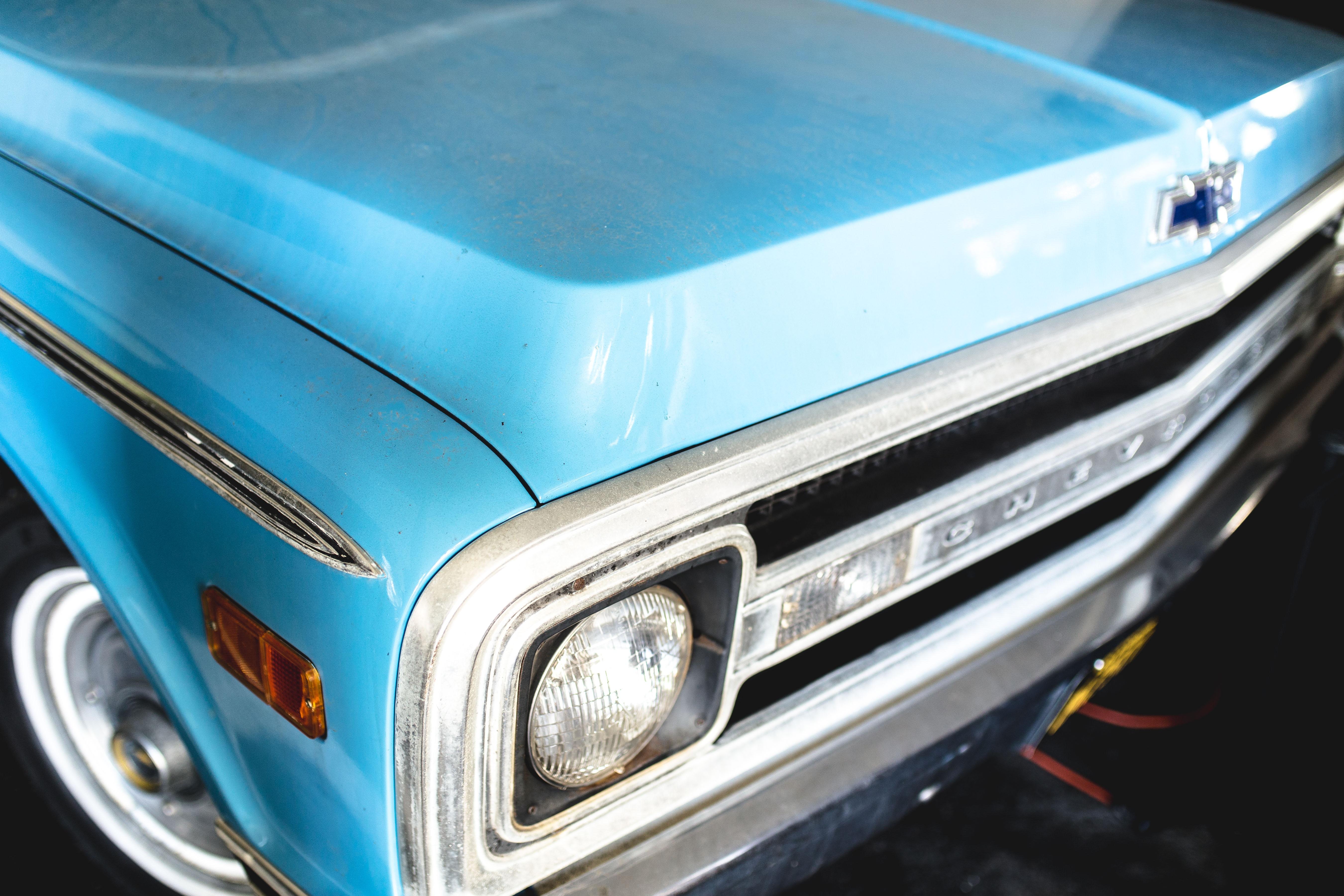 Old vintage sky blue Chevrolet front at Laguna Beach