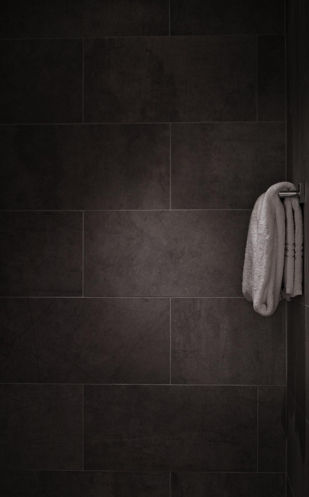 white towel in tiled bathroom
