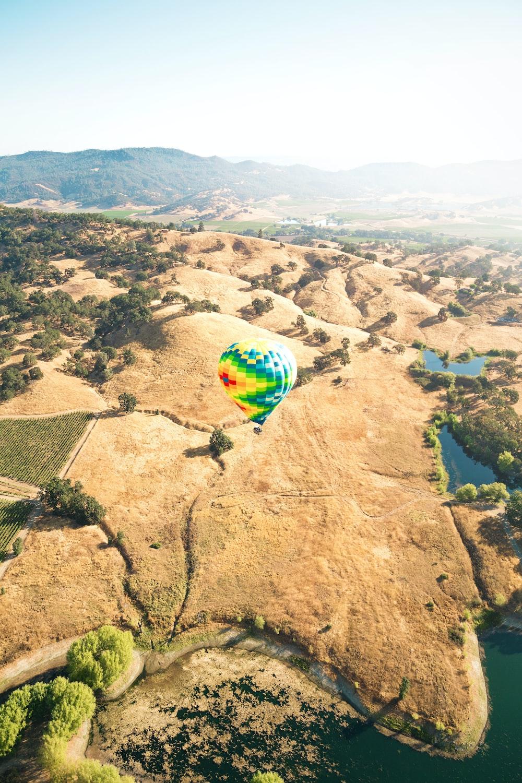 flying green hot air balloon at daytime