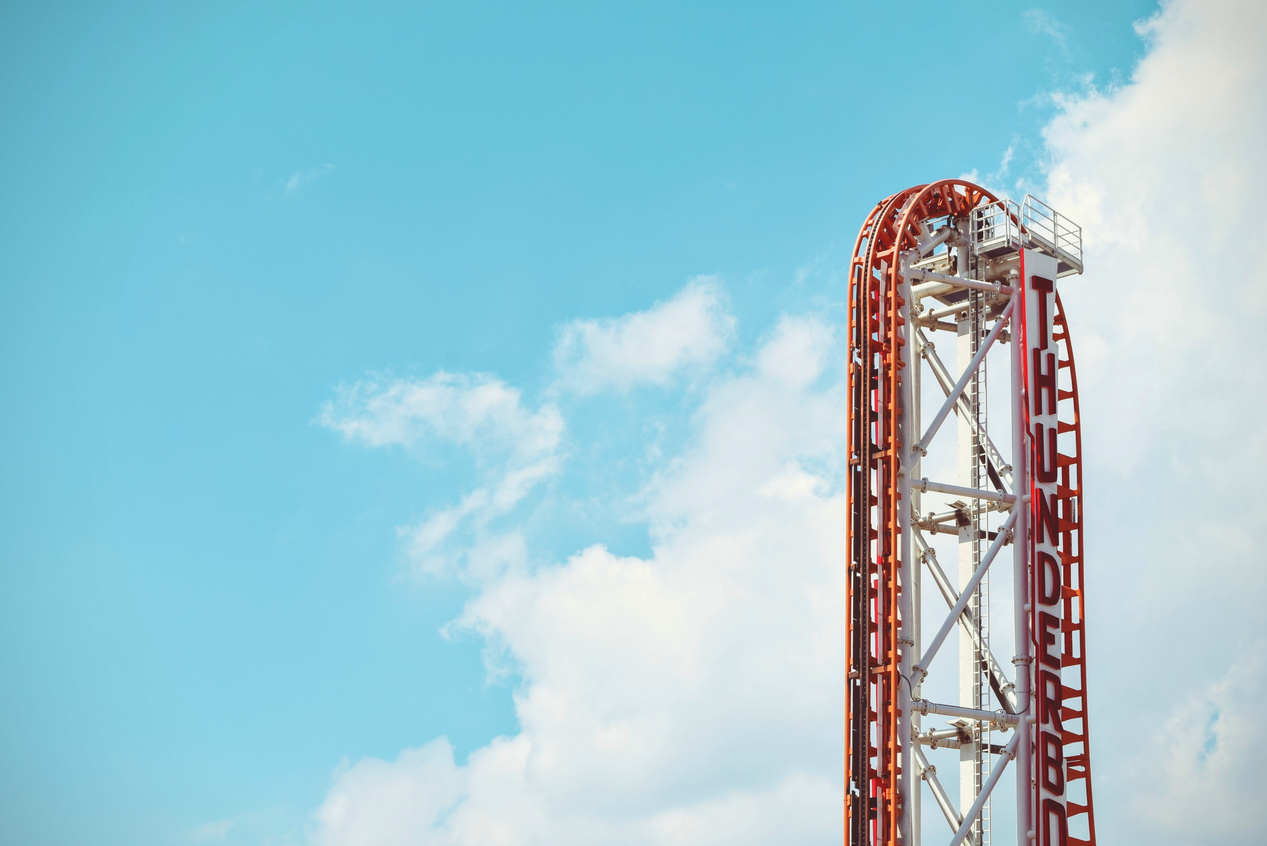 red and white Thunderbolt roller coaster ride