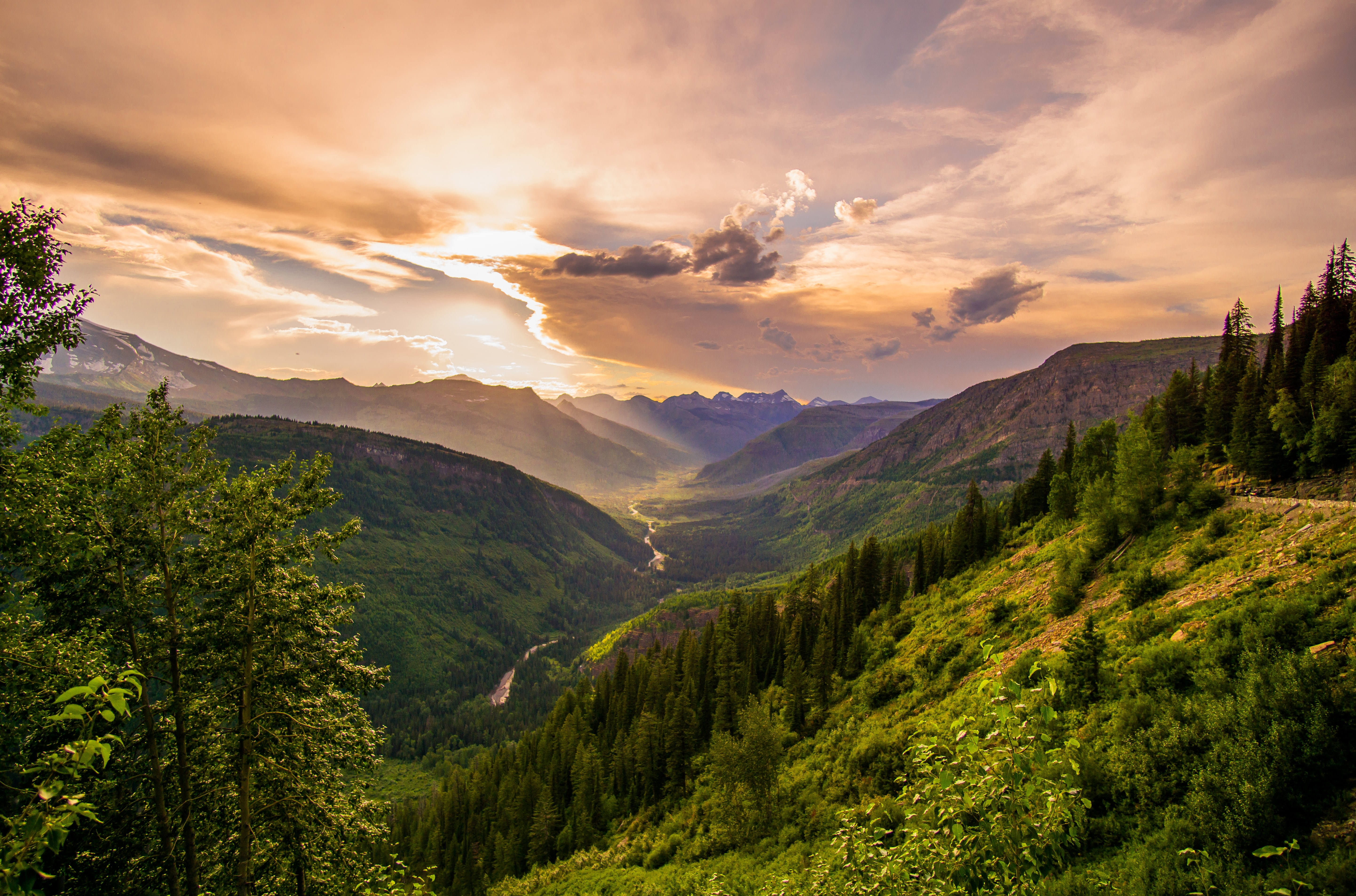 A magnificent scenery with a river in a shallow valley during golden hour