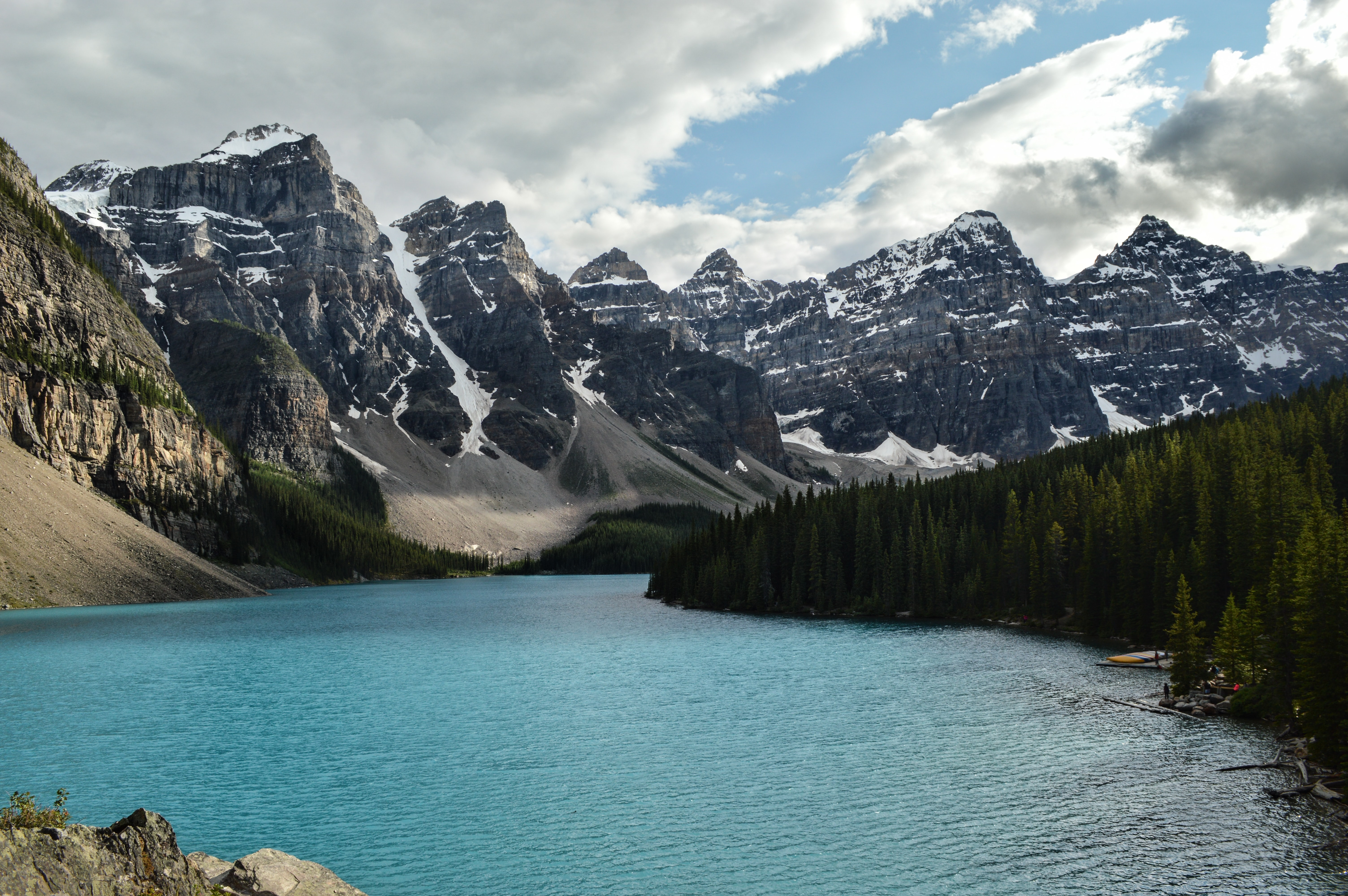 A lake stretching along snowy mountains in Banff