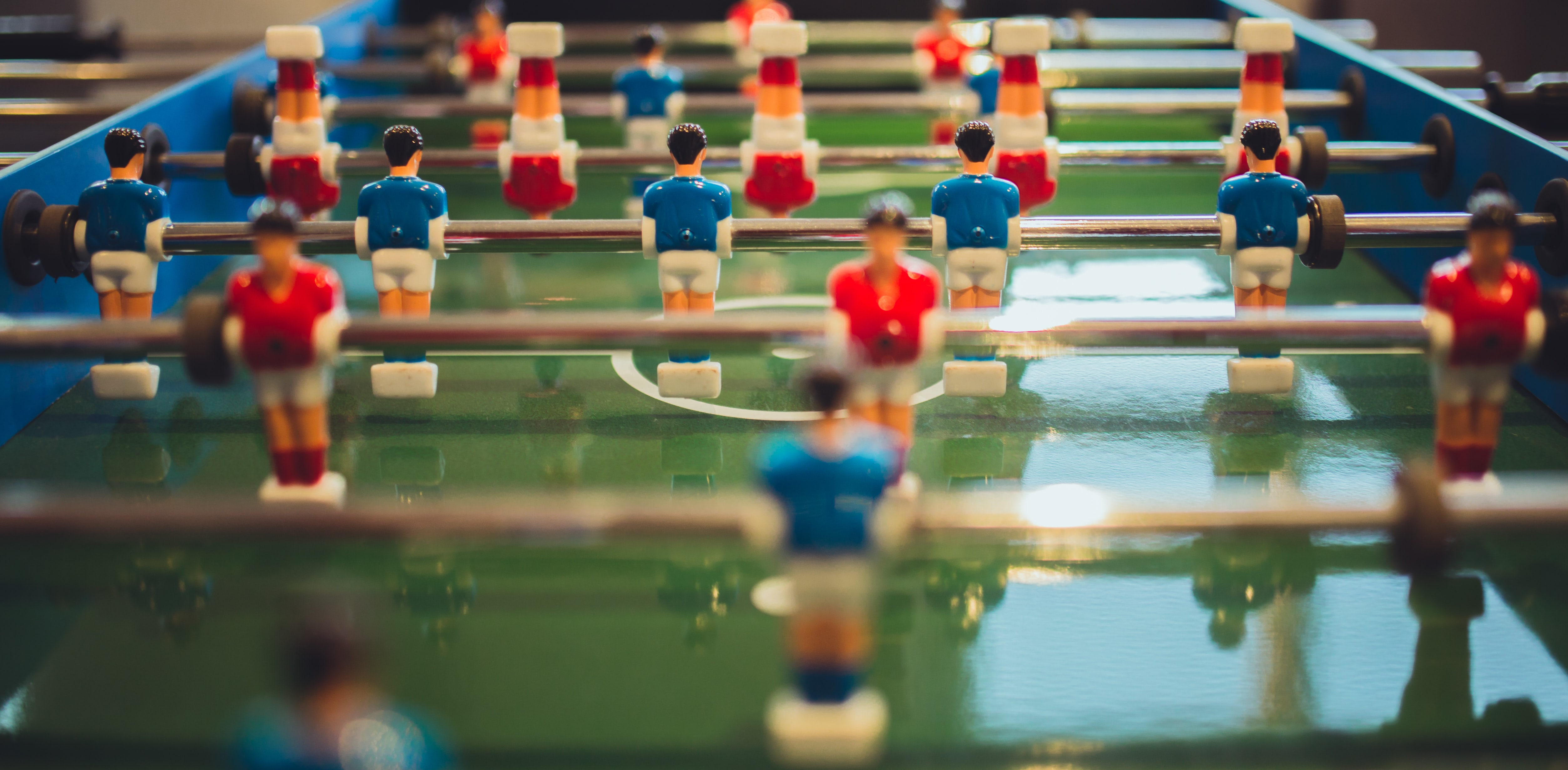 A foosball table with players wearing red and blue jerseys in Rosebank