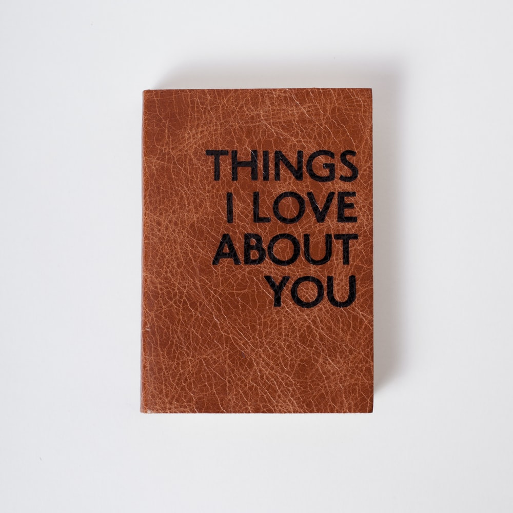 """A brown book with black writing that says """"Things I love About You."""""""
