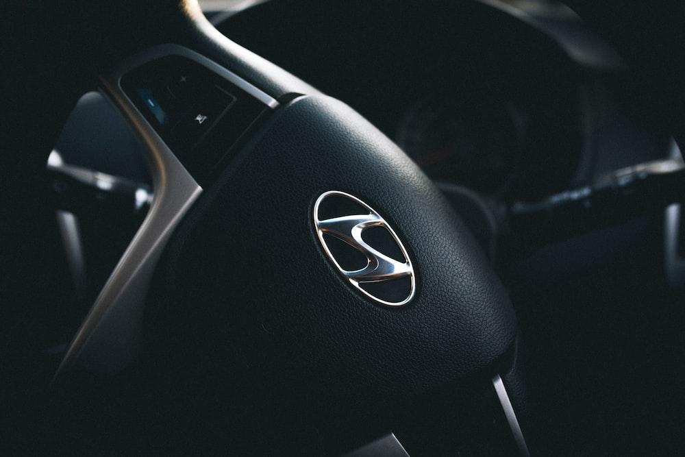 selective focus of black Hyundai steering wheel