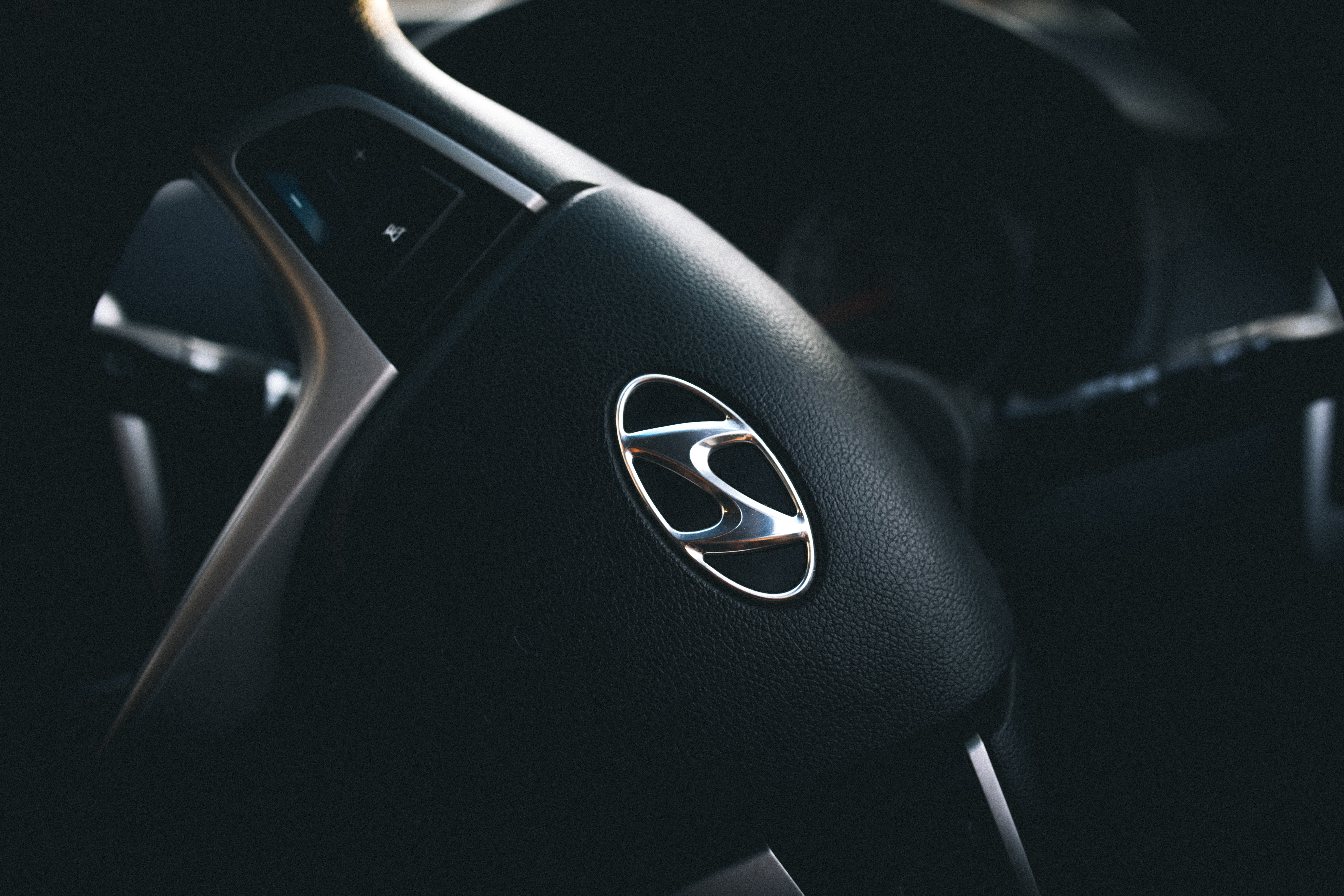 A steering wheel with the Hyundai logo