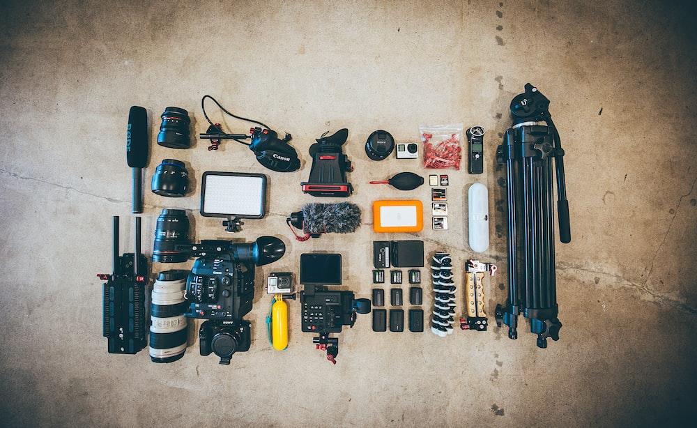 flat lay photo of camera gear on floor