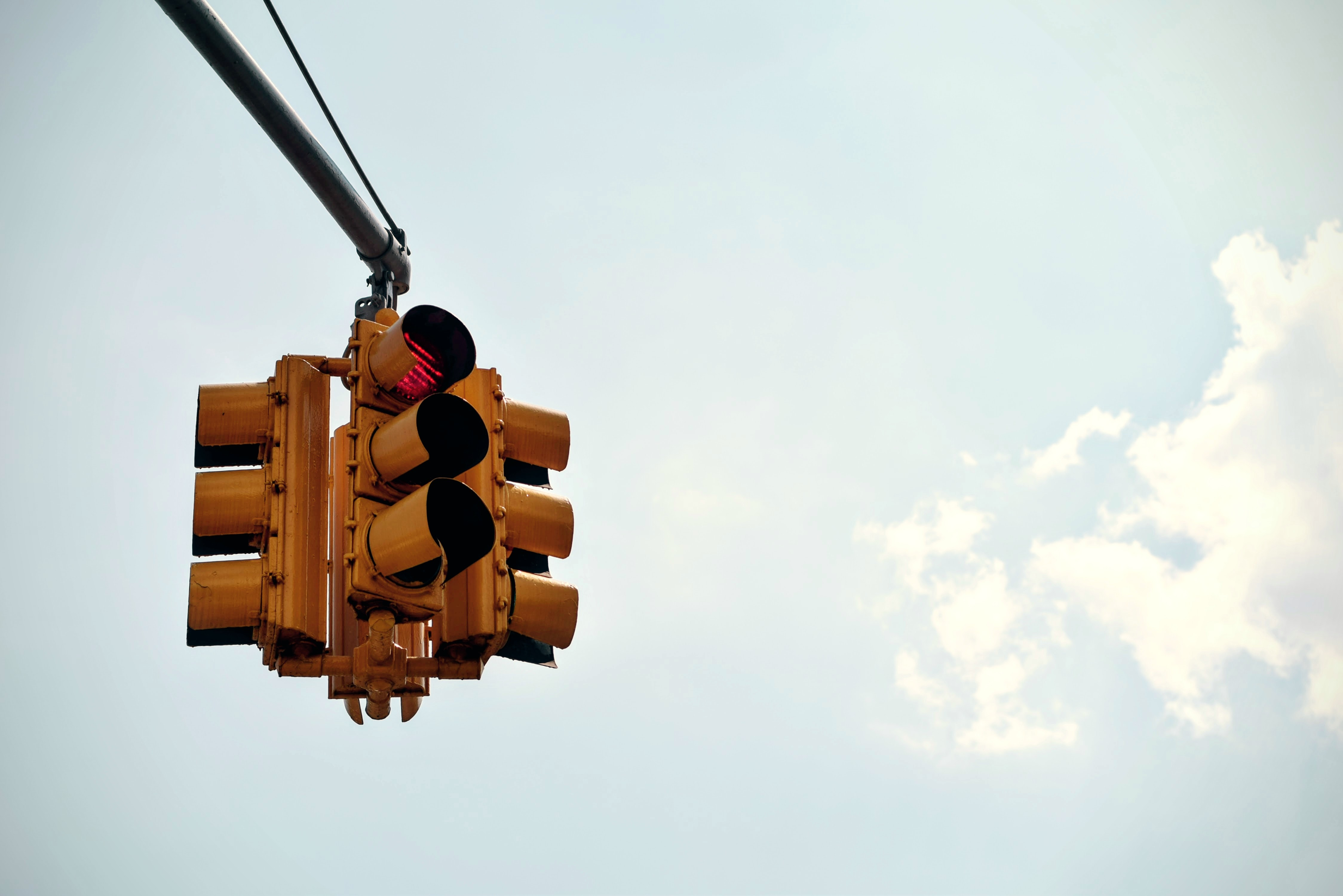 Red light on traffic lights mounted on a pole
