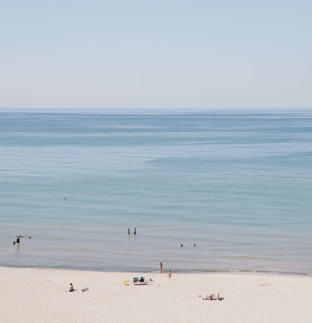 Sand beach by the calm ocean