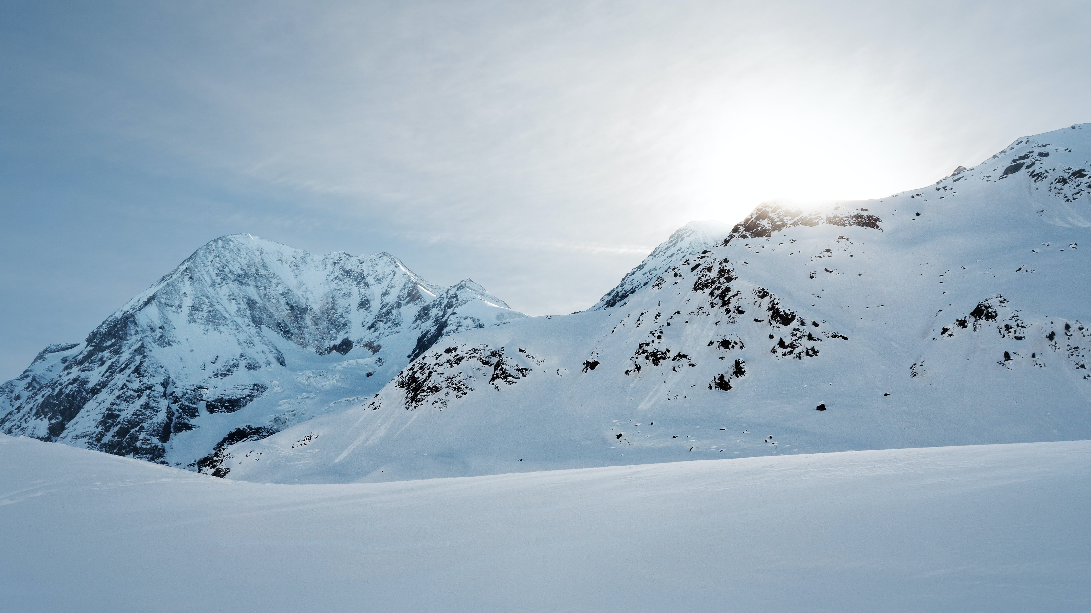 A wintry landscape with rugged peaks under a deep snow cover in Solda