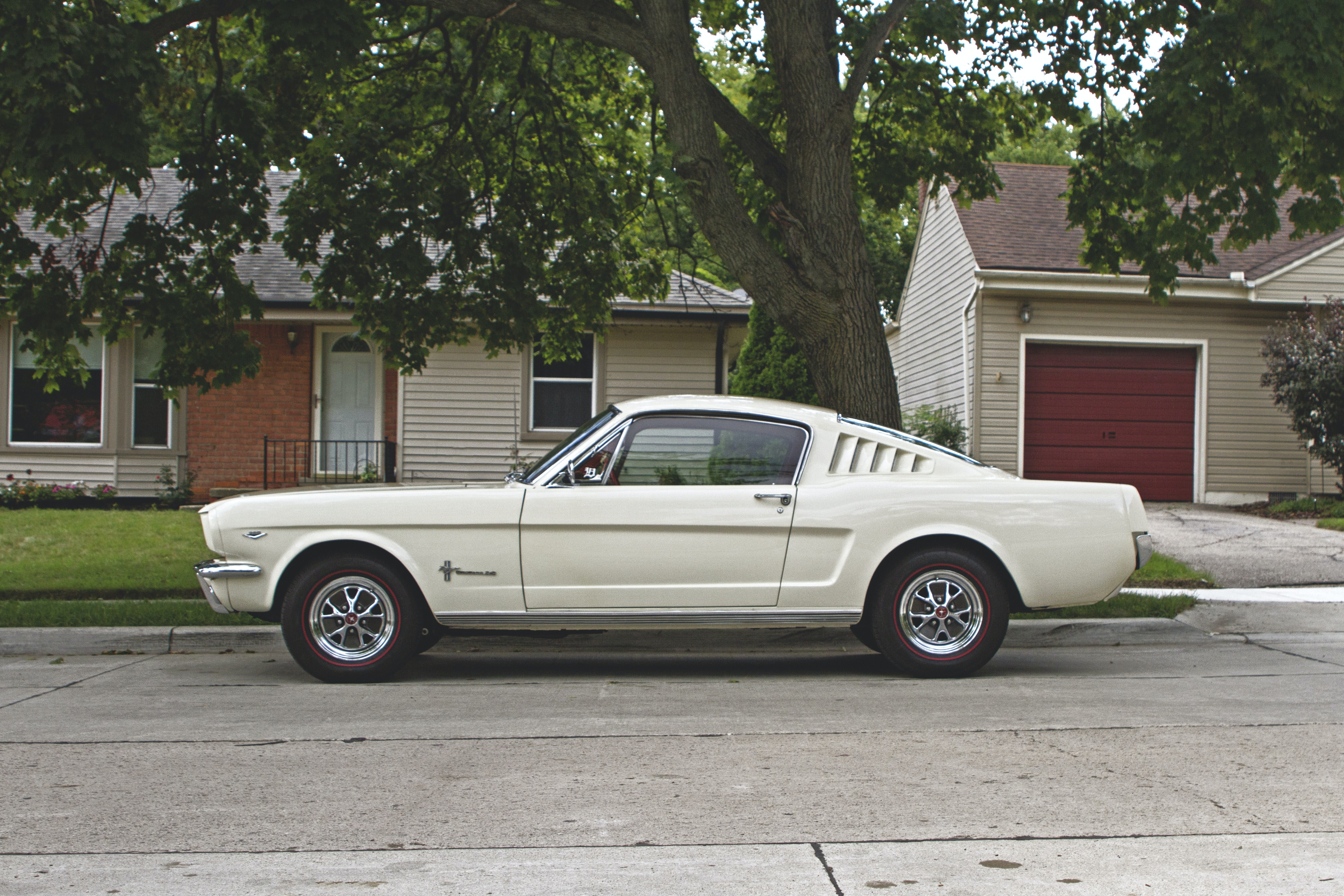 Side view of a white vintage Ford Mustang
