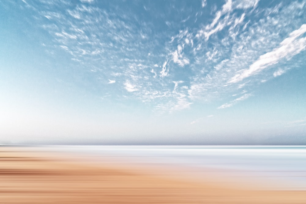 time lapsed photography of cumulus clouds - Sand Coastline On Clear Day Photo By Anthony Cantin (@arizonanthony