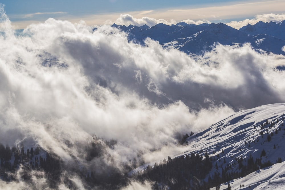 white clouds over mountain