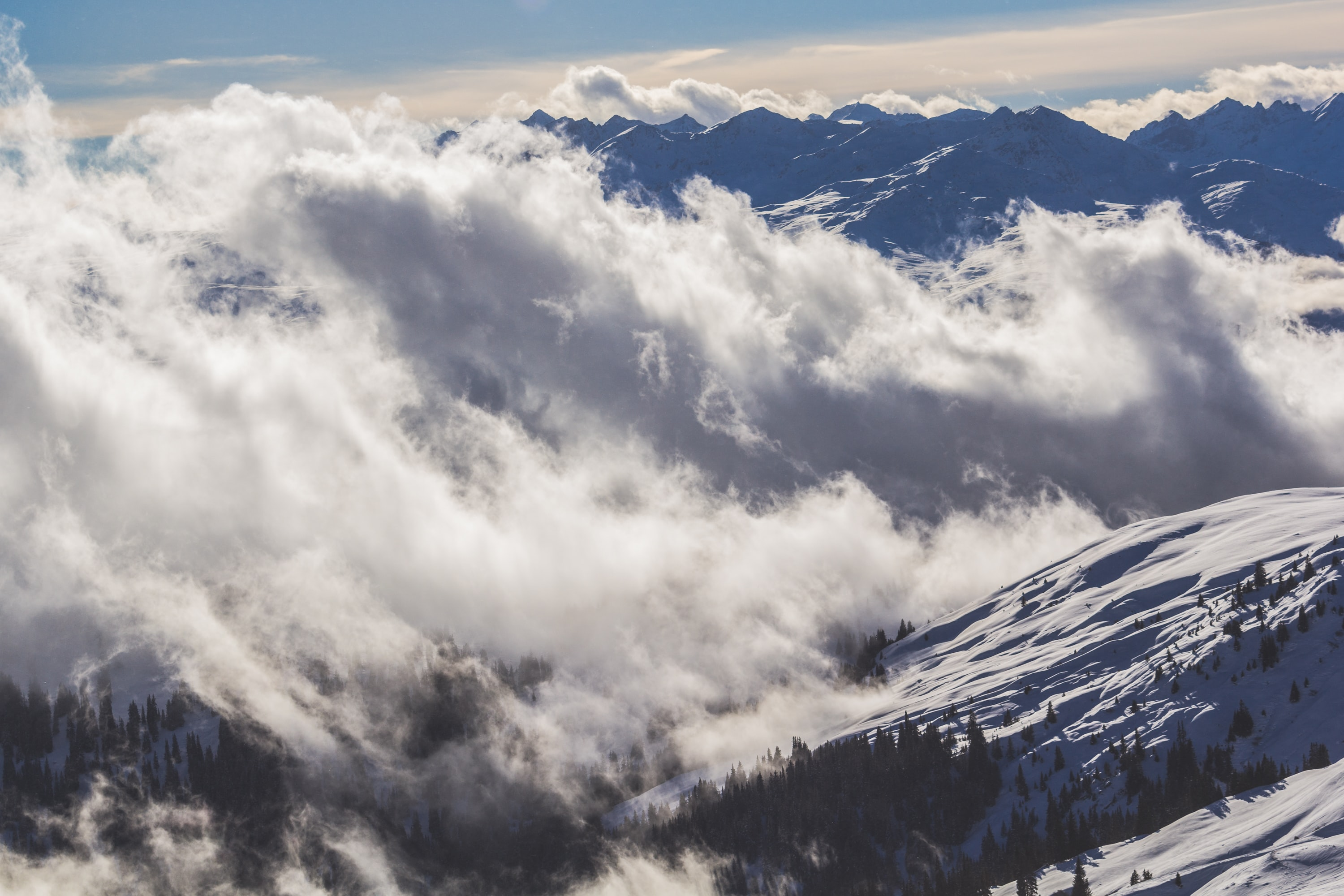 Clouds cover snowcapped mountains in Laax