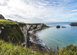 cliff near sea at daytime