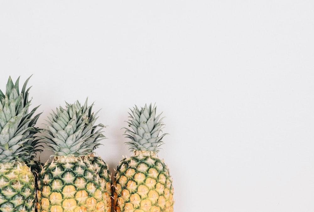 three yellow pineapples