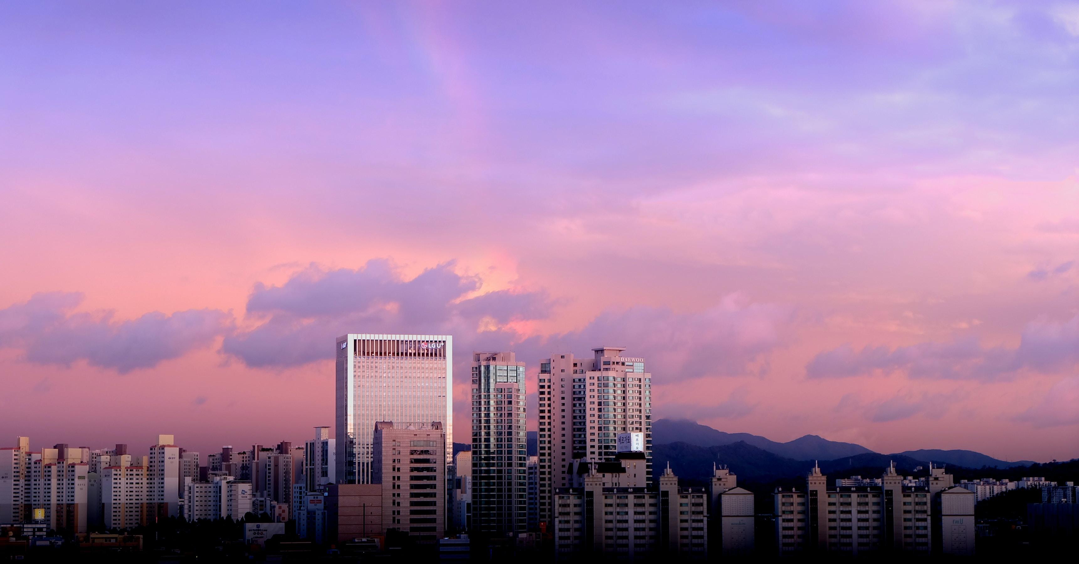 Pink and purple sunset over a metropolitan area