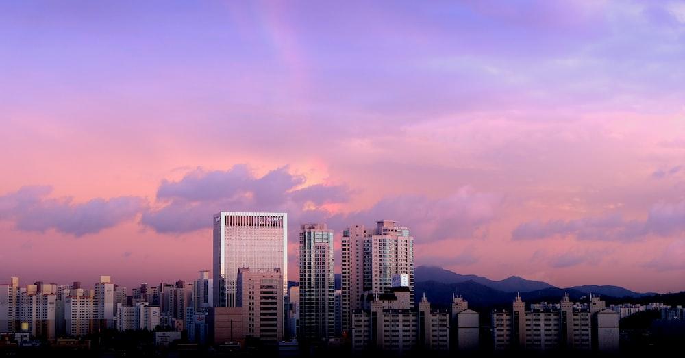 city buildings under cloudy sky